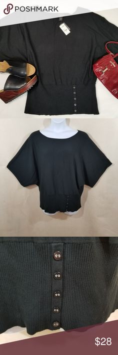 Lane Bryant Dolman Sleeve Top - Size 22/24 - NWT Essential black top for work/casual with rib trim hem embellished with decorative buttons.  The hem is not binding or tight.  Fabric feels great, combination of 77% Rayon/23% Nylon.  Length is 28 inches.  New with tags.  MSRP: $59.95 Lane Bryant Tops