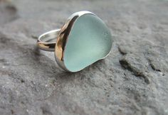 lovely....too small a size for me...but sooo pretty! Beach Glass Ring Sterling Silver Ring Size 61/2 by johnnylopov