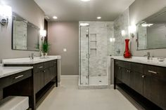 Shower Tile Layout Design Ideas... The taupe and dark cabinets with white fixtures are the color scheme we're looking at...  here we see it with a lighter floor and white-themed shower.  (Sure the marble counters and shower tiles all are similar in person; just doesn't show up in this photo.)