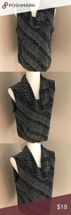 """Philosophy Black /White Sleeveless women's top Excellent condition. Women's Black/White geometric pattern Sleeveless top. Acetate/Spandex material. Size Large. Pit to pit 21"""". Pit to hem 15"""". Bin 4 Philosophy Tops"""