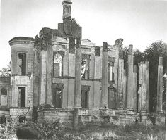 This is Belle Grove Plantation after the fire.  Notice the woman standing on the steps.  The house was HUGE!