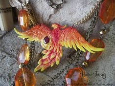 Phoenix Necklace OOAK by HiddenTreasury on DeviantArt Fake Fire, Phoenix Necklace, Fire Basket, Dragons Crown, Polymer Clay Dragon, Polymer Clay Sculptures, Clay Figurine, Sculptures For Sale, Dragon Pendant