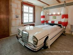 V8 Hotel, Germany. The V8 hotel is the perfect destination for car enthusiasts. Located in the city's first airport, this hotel offers car themed rooms, including a Mercedes Benz car wash, Morris Minor Garage and a Route 66 theme.