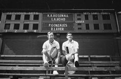 22nd August 1967: Australian tennis stars Rod Laver (left) and Ken Rosewall take a break from a practice session at Wimbledon. Laver holds a Dunlop racket while Rosewall's is by Slazenger.