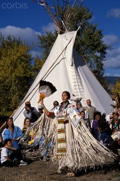 Lemhi Shoshone woman demonstrates a traditional ladies dance for an audience of tribal members during a ground breaking ceremony at the Sacajawea Center in Salmon Idaho, located along the Lewis & Clark Trail. Marilyn Angel Wynn photography