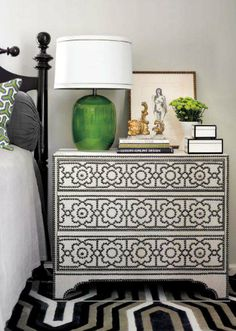 Melanie Turner - Black & green bedroom with 14th Street Antiques Market green glass lamp, Bernhardt Cabrillo Nailhead Chest, white lacquer boxes and glossy black poster bed.