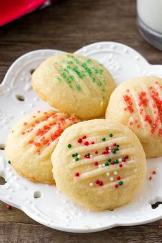 A plate of whipped shortbread cookies with holiday sprinkles. Whipped shortbread cookies are light as air with a delicious buttery flavor. They melt in your mouth because they're so soft, and only require a few simple ingredients. Holiday Cookie Recipes, Easy Cookie Recipes, Holiday Baking, Christmas Baking, Holiday Desserts, Holiday Treats, Christmas Treats, Cupcake Recipes, Christmas Recipes