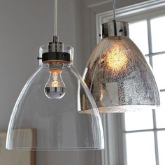 A touch of glass. Striking as a single hanging lamp and even more luminous clustered in multiples, our popular Industrial Pendant gets a glamorous new look in glass.