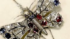 Victorian 2.35ct Diamond, Sapphire, Ruby Brooch in 9ct gold A stunning, fine and impressive antique Victorian 2.35 carat diamond, 2.52 carat natural sapphire and natural ruby, 9 carat white gold brooch in the form of a butterfly.