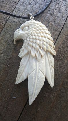 Hand carved deer antler eagle with 3 long feathers at bottom pendant necklace. Pendant comes on a leather necklace with clasp. Very beautiful work of art that you can proudly wear and display. Our uni