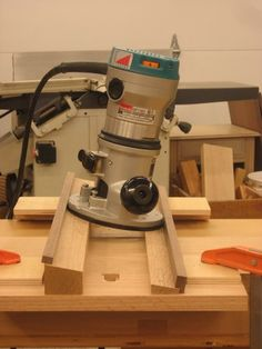 Here's a photo of the jig with the router. The angle is 11 degrees, and the router base is 5 3/4″ diameter.