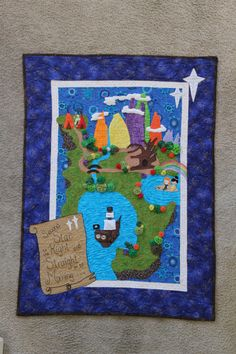 A Quilted Map of Neverland, complete with pirates, mermaids and Peter Pan in doll form to go along with it. Crib Size. Too fun It took six months, but I finally FINISHED!
