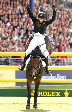 With a Samshield helmet on! Janne Friederike Meyer in the 2011 Rolex Grand Prix of Aachen aboard her famous stallion Cellagon Lambrasco.
