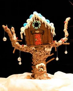 A House in a Tree Perched high in a Rice Krispies tree and decorated with icicles, blue shutters, and a lace roof, Sara_and_Vanessa's gingerbread tree house took them 17 hours to complete. Graham Cracker House, Graham Cracker Gingerbread House, Cool Gingerbread Houses, Christmas Gingerbread House, Christmas Cookies, Christmas Houses, Christmas Trees, Christmas Decor, Merry Christmas