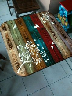 Colored wood table with white stencil
