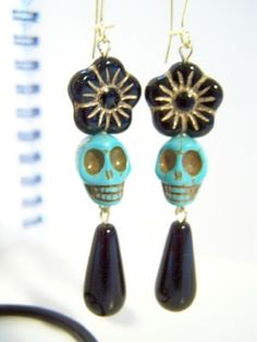 These calavera earrings would be perfect for Dia de los Muertos along with some Frida-style braids.