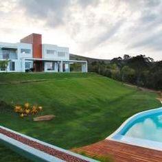 Casa Minas Gerais : Casas Moderno por Carlos Salles Arquitetura e Interiores