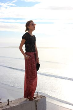 Patterned palazzo pants, lacey top, colored sunglasses...