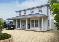 This house in Bosham, West Sussex sits in a lovely village. Originally designed as a refurb became a new build using that is now a clean and spacious home