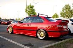 Hellrot BMW e36 coupe on OEM BMW Styling 5 a.k.a. BBS RC wheels