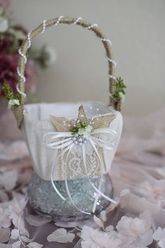 This is the perfect basket for that chic rustic wedding! I purchase natural baskets in their raw state and then begin the creative process. I pride myself on creating flower girl baskets that are truly unique designs with a distinct handmade flair. The basket is covered with an unbleached osnaburg