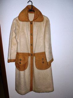 Bonnie Cashin cream brushed mohair (not really faux fur - it's a couture fabric we don't see much of these days) unlined coat with suede collar, front band and pocketbook pockets. Turnlocks to close.