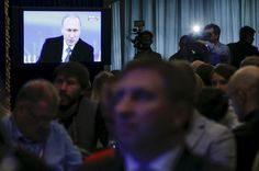 Journalists gather at a media centre as they watch a live broadcast nationwide call-in attended by Russian President Vladimir Putin in Moscow April 16, 2015. REUTERS/Maxim Shemetov