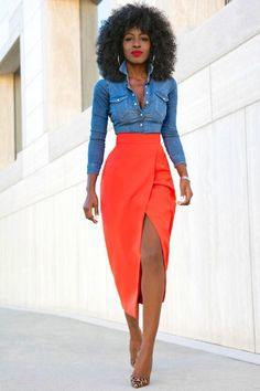 Show off your playful side in a blue denim shirt and a red slit midi skirt…
