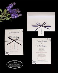 Vintage wedding invitations finished off with double satin ribbon and tag