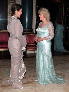 The Duchess of Cornwall (R) greets Princess Lalla Meryem of Morocco before a dinner for foreign sovereigns to commemorate the Diamond Jubilee at Buckingham Palace, in London