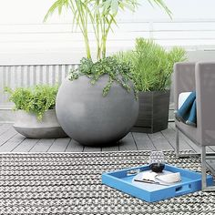 Outdoor Space >> Ball Planters | Crate and Barrel (notes: for atrium and/or front stoop)