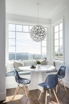 David Duncan Livingston Photography documents a blue breakfast nook with a window seat visualizing a gorgeous landscape view.