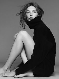 Top model Daria Werbowy; turtleneck with deep-colored lipstick and loose hairstyle.