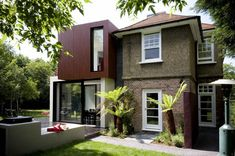 Modern extension on a property. Great use of colour. How much is your property worth and how to add value to your home? Here are the best home improvement projects to help you add value to your home House Extension Cost, Extension Veranda, Building Extension, Extension Designs, Rear Extension, Extension Ideas, Architecture Art Design, Residential Architecture, 1930s House