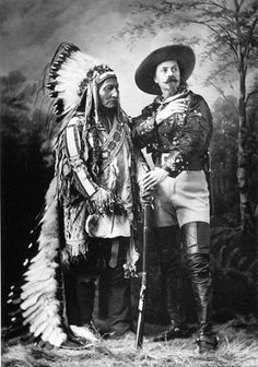 Sitting Bull in his Wild West Show costume with Buffalo Bill. The full warbonnet was a prop used in Buffalo Bill's Wild West Show. When not performing, Sitting Bull wore only one feather.