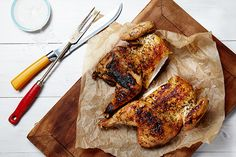 Find the recipe for Garlic and Herb Spatchcock Grilled Chicken and other garlic recipes at Epicurious.com