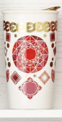 Double-walled ceramic mug ornamented with designs of diamonds, rubies, and pearls. #Starbucks #DotCollection