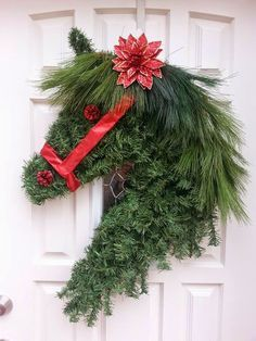 Horse's head Christmas Wreath - white pine used for the mane. Image of metal frame included.