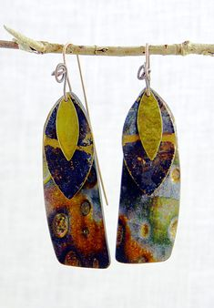 In the spirit of the season, I decided to use up my 'orphan' beads and create 12 earring sets.   These combine mokume gane polymer dangles with repurposed patinated brass elements.  For the complete description, see  storiestheytell.blogspot.com/2011/12/twelve-pairs-of-earr...