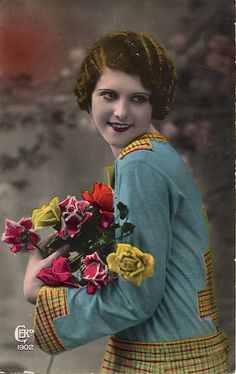 Vintage tinted postcard of a girl with flowers, c.1920s