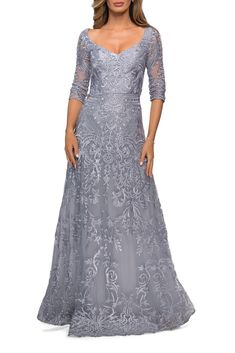 Long embroidered lace gown with V neckline, three-quarter sleeves, and A-line body style. Back zipper closure. Please review size chart B for measurements of each La Femme size option. Fabric: Lace Length (hollow to hem): Approx 60 inches Style Features: Long Dresses, V-Neck, Three Quarter Sleeves, Lace, Embroidered, A-line Older Bride Dresses, Formal Dresses For Weddings, Wedding Dresses, Over 50 Wedding Dress, Long Gown Elegant, Prom Boutiques, Full Length Gowns, Long Evening Gowns, A Line Gown