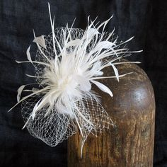 Ivory veil with spiky feather spray by alicehartcouture on Etsy, $94.00