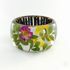 Fortress Bangle, Flowers and Small Branches casted in clear resin. Unique resin jewelry by Oksana Bell