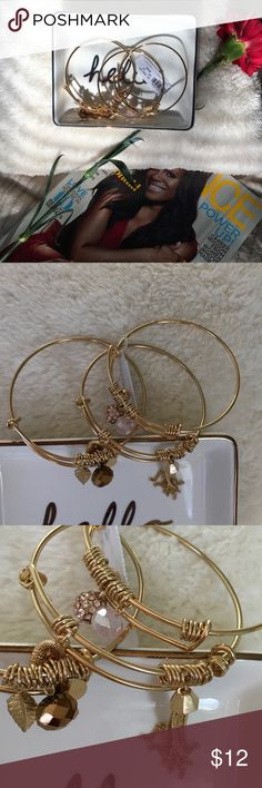 BRAND NEW! Three gold bracelet set Super cute and glam bracelets with gold and pink pendants. Comes with original packaging. I have one of these. New York & Company Jewelry Bracelets