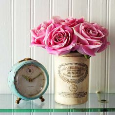 A teal #antique clock and vintage container look lovely on a bathroom shelf. More Flea Market Accents: http://www.bhg.com/decorating/decorating-style/flea-market/flea-market-chic-home-accents/?=bhgpin042212clockandcontainer
