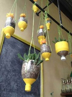 Hang It DIY Hanging Planters Ideas Tutorials Soda containers dipped in paint Love this would be a fun science activity that would also be classroom decor Reuse Plastic Bottles, Plastic Bottle Crafts, Recycled Bottles, Plastic Bottle Planter, Plastic Bottle House, Diy Hanging Planter, Planter Ideas, Diy Planters, Garden Planters