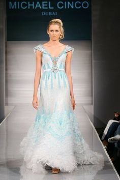 Michael Cinco| 08-09 wedding collection: Non-white| beach wedding dress| Tropical wedding dress.
