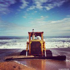 Bulldozer stuck in the sand in Kitty Hawk, North Carolina.