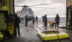 Military members move a torpedo towards a helicopter on a ship's deck Royal Canadian Navy, Canadian Army, Armed Forces, The Past, Deck, Ship, Helicopters, Arsenal, History