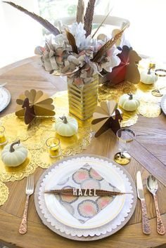 Use a package of feathers from the craft store to make the simplest name cards yet. The only other supply you'll need are letter stickers. Click through for more.  #ThanksgivingTableSetting #ThanksgivingTableSettingSimple #ThanksgivingTableSettingElegant #ThanksgivingTableSettingRustic #ThanksgivingTableSettingOnABudget